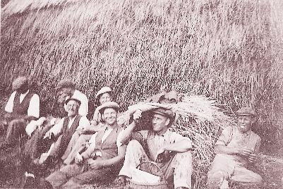 Farm workers take a rest by haystack, c.1938