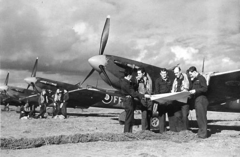 Pilots standing beside Spitfires at Newchurch*